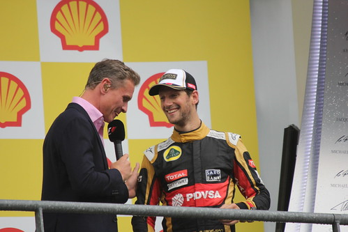 David Coulthard interviews Romain Grosjean on the podium after the 2015 Belgium Grand Prix