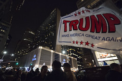 Donald Trump supporters waving a large Trump flag outside Hilton Midtown in Manhattan, New York City on election night, November 8, 2016.