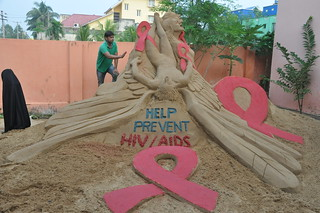"""One sand sculpture with a message """"HELP PREVENT AIDS/HIV"""" on beach puri"""