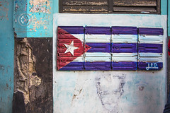 The Cuban flag painted on the wall in Havana.