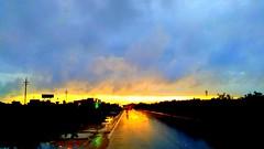 Urban sunset.  A rainy evening sunset
