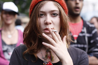 Woman in a hat, smoking