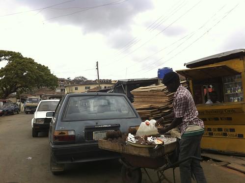 Coconut seller in Okene Kogi State Nigeria by Jujufilms