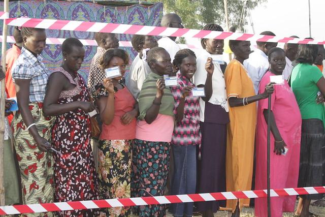 Women Holding Registration Cards