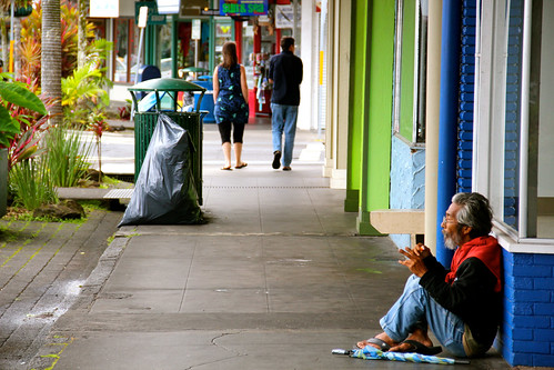 Homeless asian man on the sidewalk