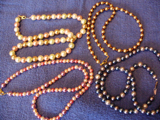 Glass Pearls made into different necklaces of different colors pink, cream, blue, grey