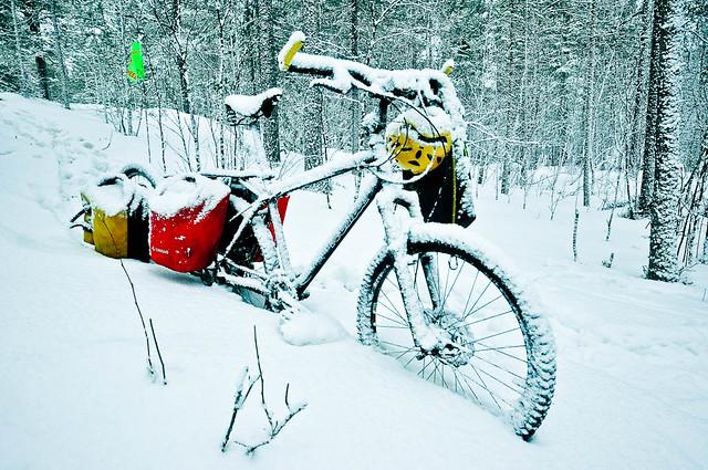 Snow coated bike