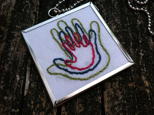 embroidered hands charm