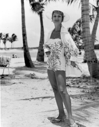 A fashion model in swimsuit poses at Matheson Hammock Park beach: Miami, Florida