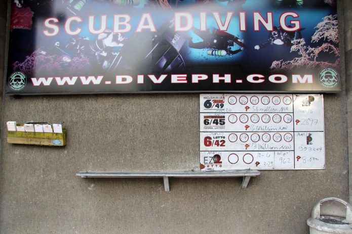 lottery outlet below scuba diving sign