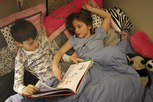 slumber party, with a book