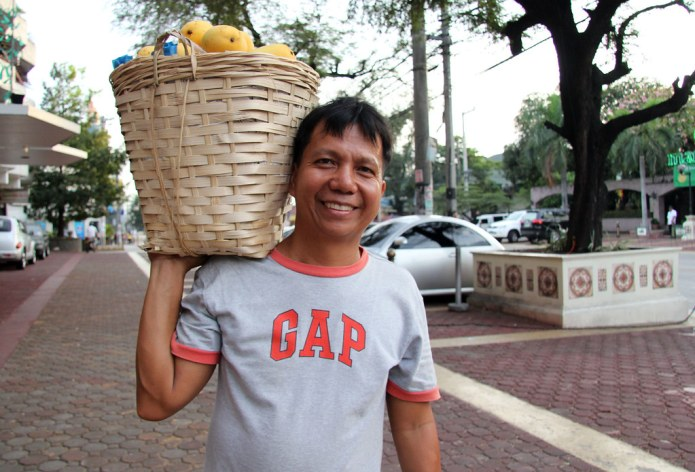 street portraits- vendor with a basket of mangoes