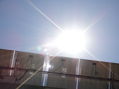 sun over solar panels