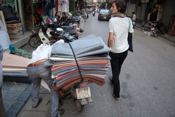 Guy loads Textiles on Scooter