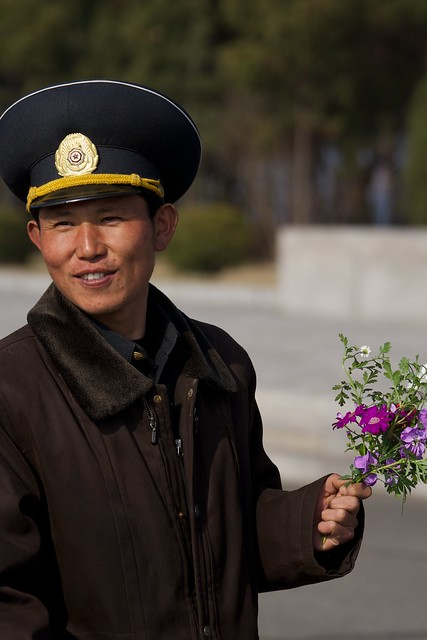 North Korean Soldier/Sailor with Flowers