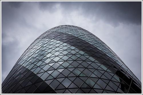The Gherkin under a dramatic sky (London)
