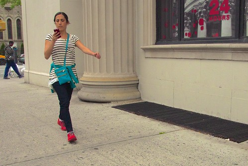 A sign of the times: cellphones and brightly-colored shoes