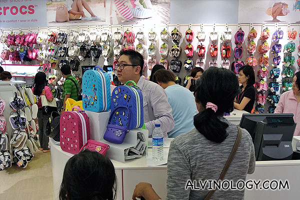 Me working part-time at Crocs (kidding... I was handling the bloggers registration)