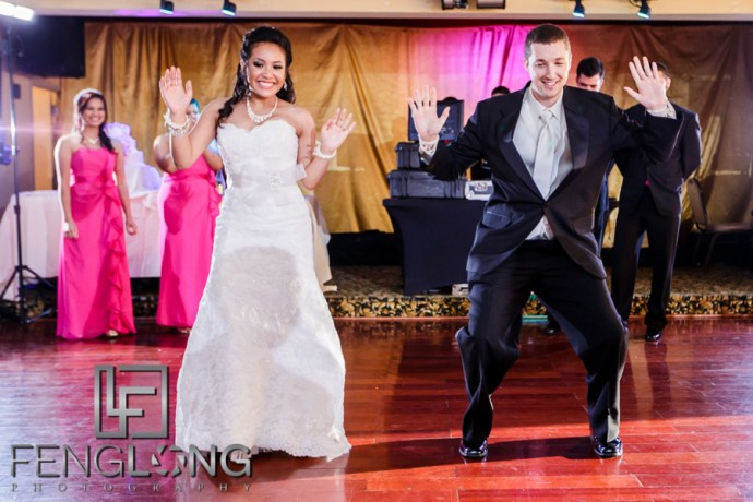Cambodian bride and groom dance during reception in Western wedding attire