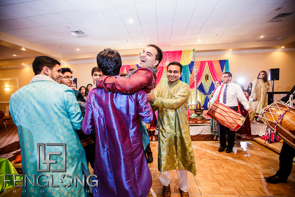 Carrying groom in the air for entrance
