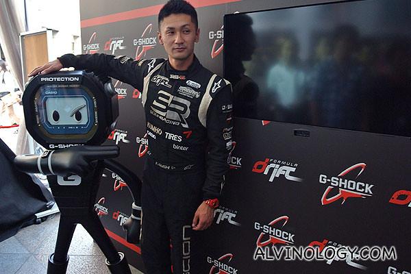 Ken Gushi posing with a Casio G-Man