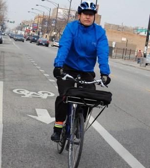 Brendan Kevenides biking on Milwaukee Avenue