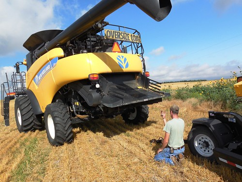 Eric hooking up the header to the combine
