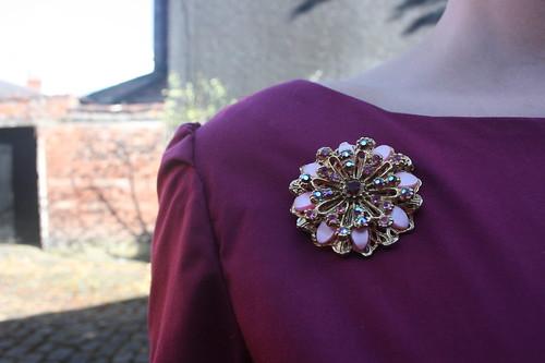 Burgundy ruffle dress brooch