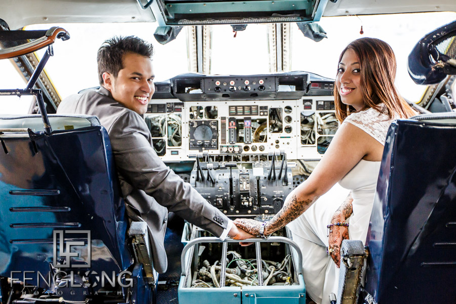 Indian Bride and groom in cockpit of cargo plane for pre-wedding shoot
