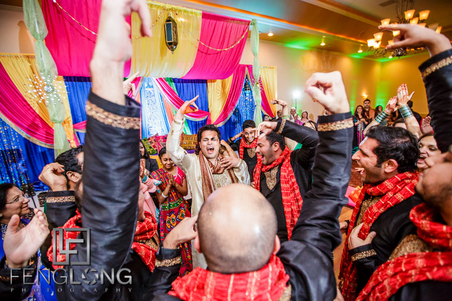 Groom and family dancing during Indian Ismaili wedding