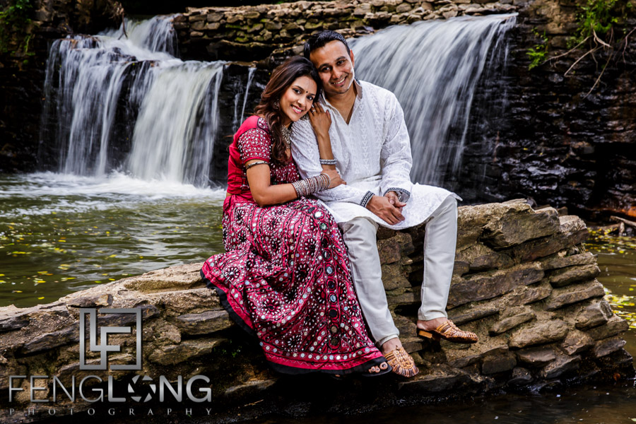 Indian bride and groom in front of a waterfall in Atlanta
