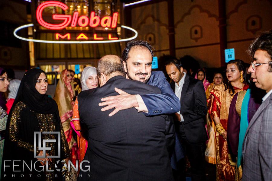Two fathers hug