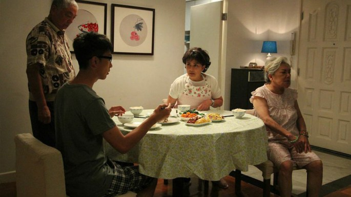 At the end of a tiring day at work, Ah-Oi still has to prepare dinner for her unappreciative family. Credit: Singapore Chinese Film Festival
