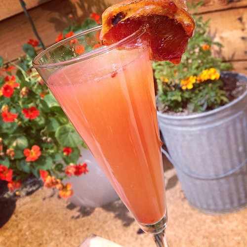 Best Mimosa Ever! Champagne, Cointreau, grapefruit bitters and caramelized blood orange.