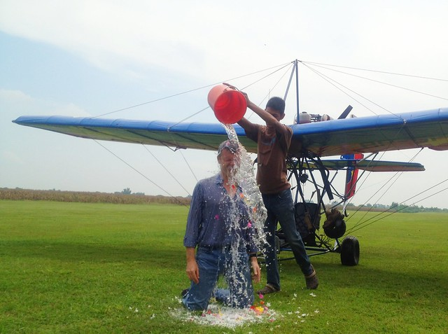 My first solo flight. Tradition is that once you complete that, you have to kneel in the grass and all the mechanics pour buckets of water (and whom knows what else besides flowers) over you ...