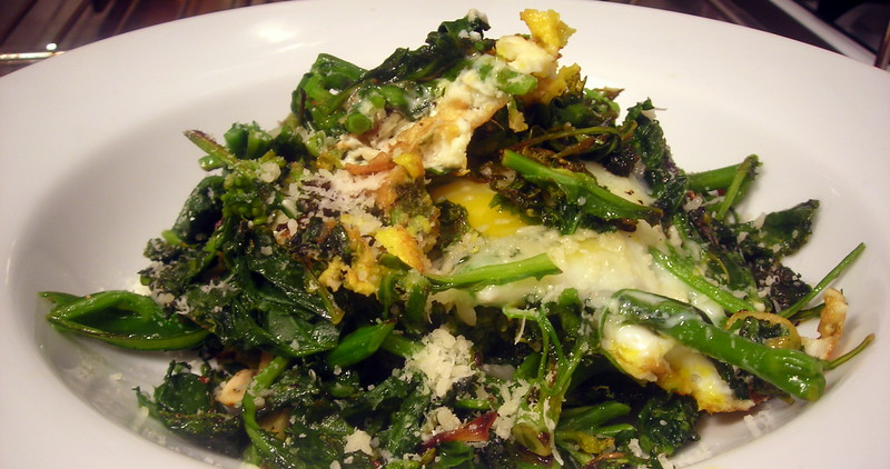 Kale, with garlic, lemon zest, fried farm egg and Parmigiano-Reggiano cheese