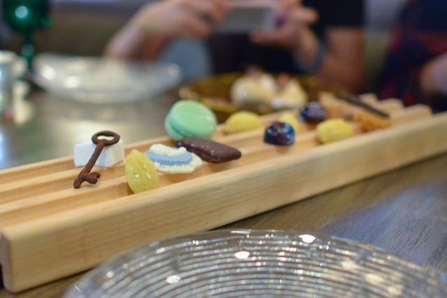 mignardises chocolates, passion fruit mashmallow, petite madeleine, almond biscotti, chocolate truffle