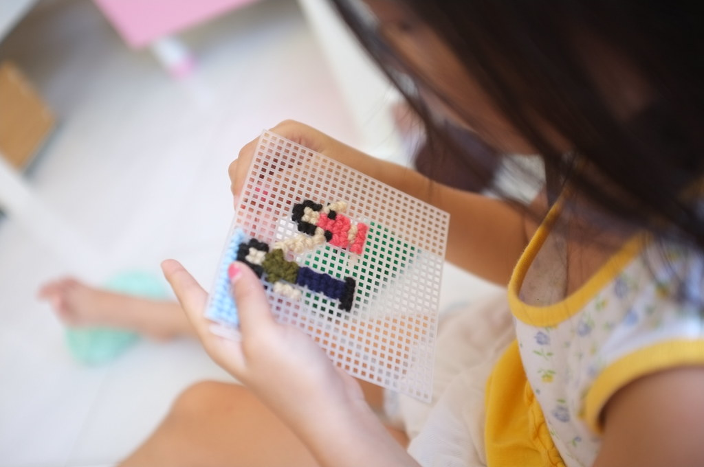 learning to do cross-stitching...