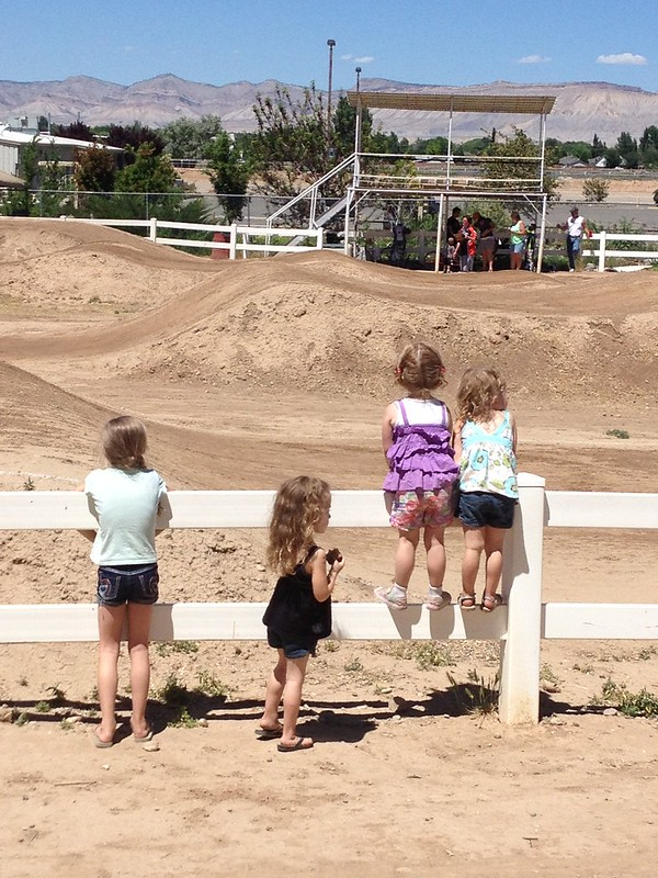 The girls watching the boys ride