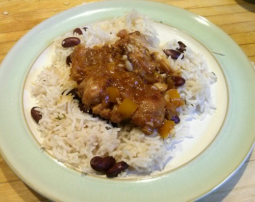 brown chicken stew with rice and peas
