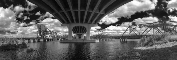 Underneath the bridge over the St. John's River by the old bridge and railroad trestle