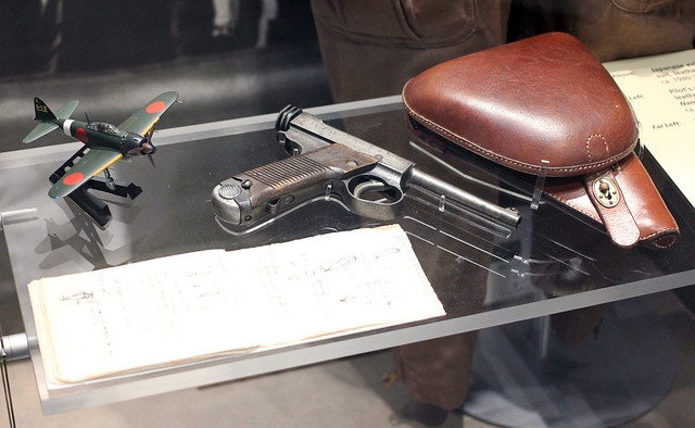 gun and model aircraft