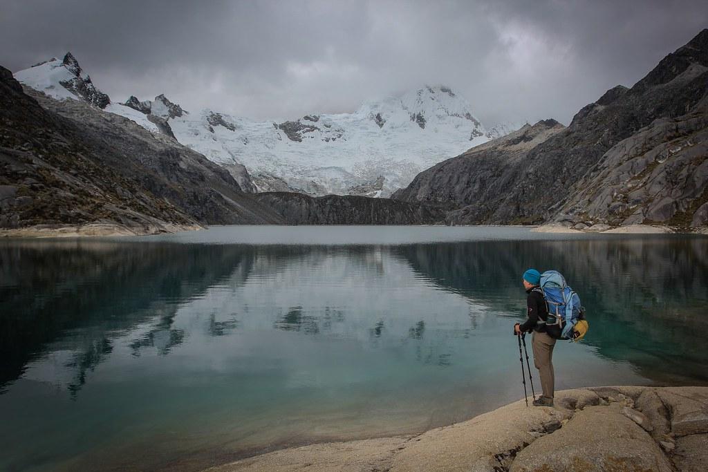 Laguna Cullicocha reflects the complete Santa Cruz (6241m) massif. Huascaran National Park. Cordillera Blanca. Peru.