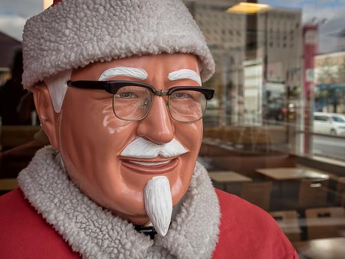 the colonel dressed as santa (japanese kfc)