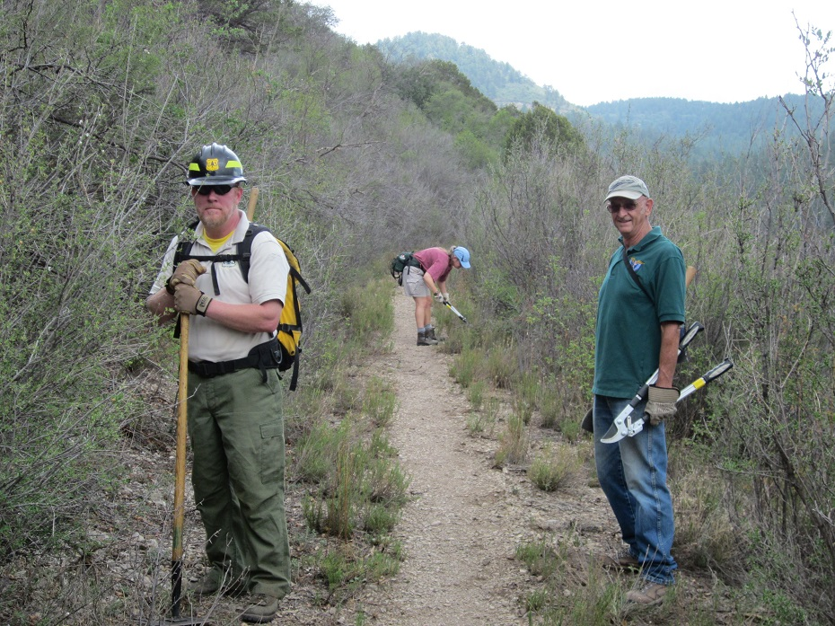 New Mexico Rails-to-Trails volunteers and Forest Service rep working on Switchback Trail