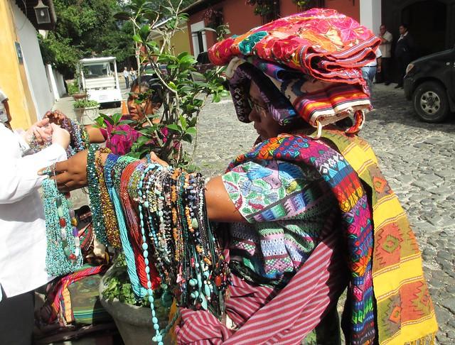 Clara's Sister Selling Fabrics, Necklaces Outside Porta Hotel, Antigua, Guatemala, May 2014
