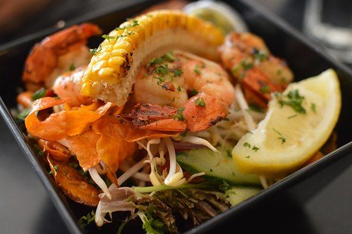 Grilled prawns with salad greens