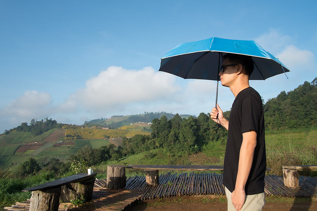 Chai, with cool blue umbrella, at Mon Cham