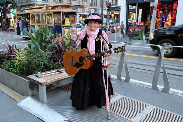 Old lady playing rock in the street