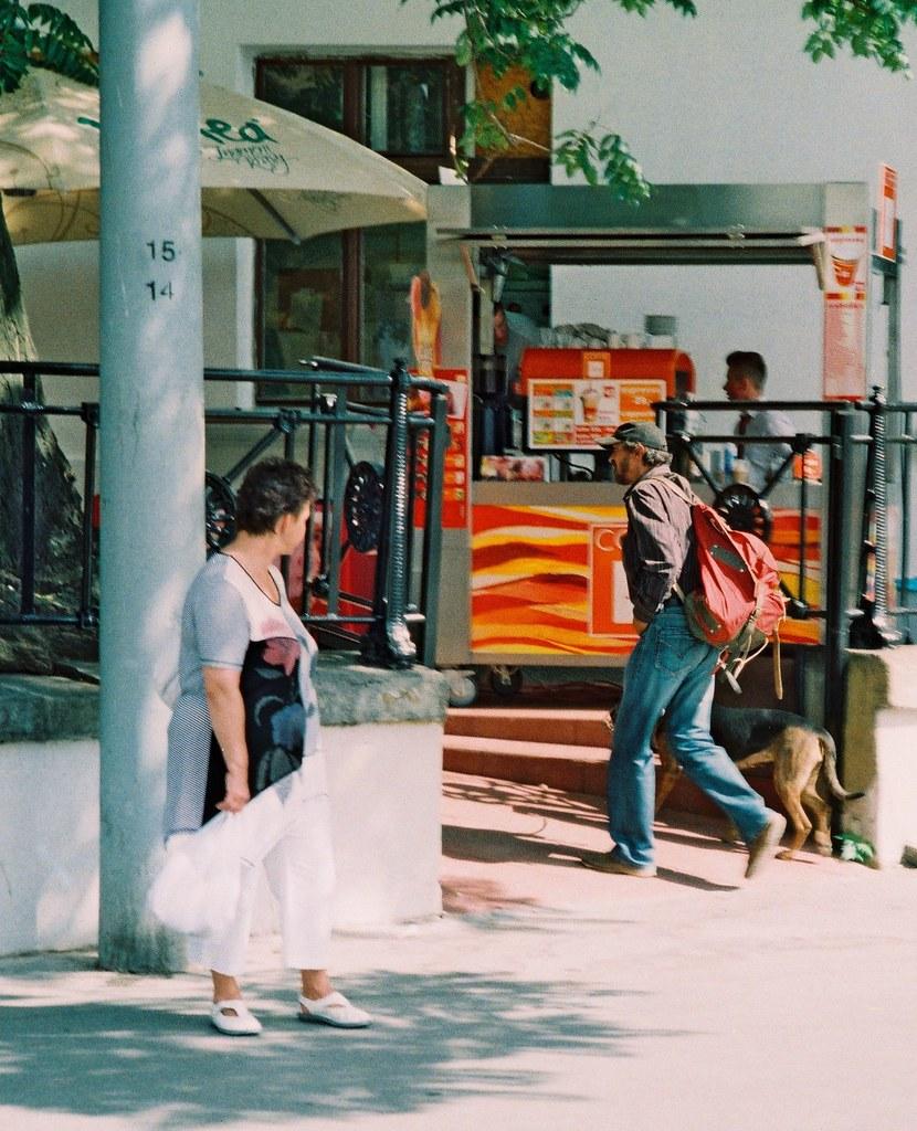 Woman Looking at Man Entering the Restaurant (Kiev camera)